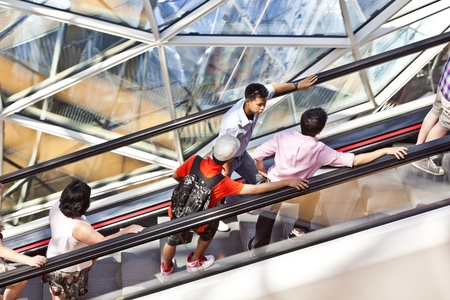 FRANKFURT, GERMANY - AUGUST 21: people on the long moving staircase visit myZeil center on August 21,2010 in Frankfurt, Germany. The modern building by architect Fuksas was inaugurated in 2009.