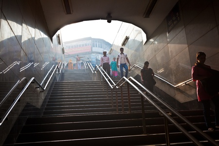 people enter the metro station in old delhi early morning