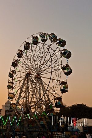people enjoy the big wheel in the amusement park in Delhi in front of the red fort Stock Photo - 11287110