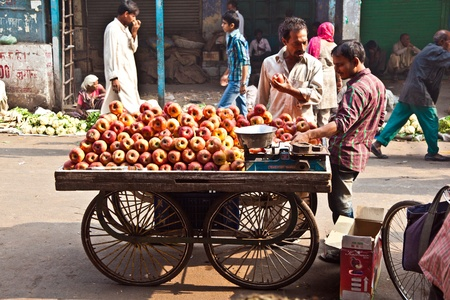 DELHI, INDIA - NOV 9: people sell apples at Chawri Bazar on November 08,2011 in Delhi, India. Established in 1840, with a hardware market, it was the first wholesale market of Old Delhi. Stock Photo - 11302324