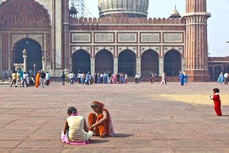 DELHI - NOVEMBER 09: Muslim pilgrim family visiting the Jama Masjid mosque on November 09, 2011 in Dehli, India. Jama Masjid is the largest mosque in India with millions of visitors each year. Stock Photo - 11314457