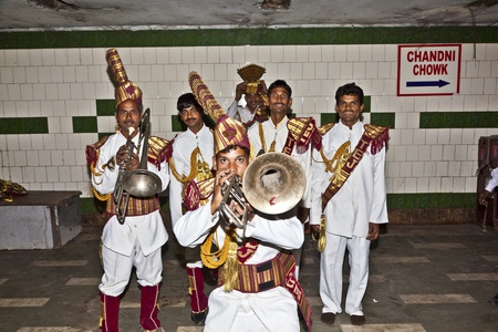 repertoire: DELHI - NOVEMBER 09: Members of a brass band show their repertoire to the audience in a passage underground on November 09, 2011 in Dehli, India. Brass Bands were introduced to Indian culture by the English. Editorial