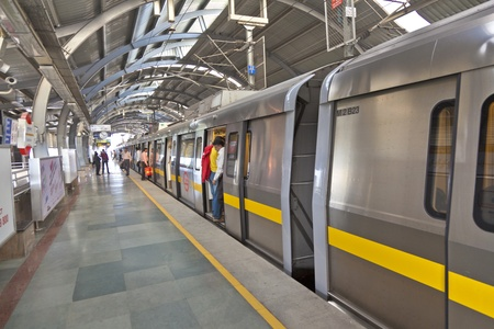 DELHI - NOVEMBER 11: passengers alighting metro train on November 11, 2011 in Delhi, India. Nealy 1 million passengers use the metro daily.