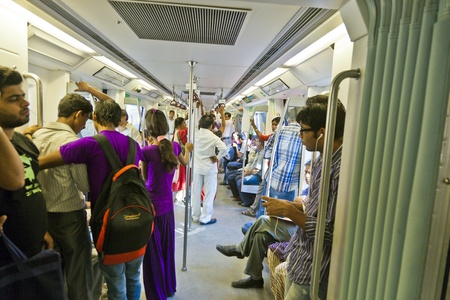 DELHI - NOVEMBER 11: passengers alighting metro train on November 11, 2011 in Delhi, India. Nealy 1 million passengers use the metro daily.