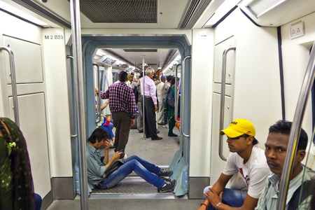 DELHI - NOVEMBER 11: passengers alighting metro train on November 11, 2011 in Delhi, India. Nearly 1 million passengers use the metro daily.