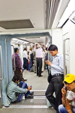 DELHI - NOVEMBER 11: passengers alighting metro train on November 11, 2011 in Delhi, India. Nearly 1 million passengers use the metro daily.