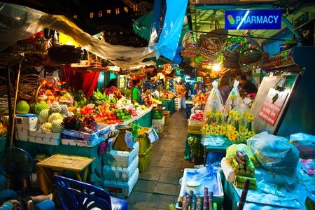 BANGKOK, THAILAND - JANUARY 5: colorful flowers at the flowermarket in Bangkok with shops January 5, 2010 in Bangkok