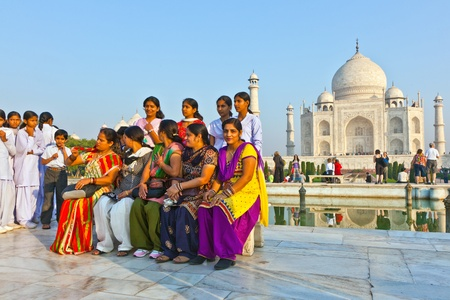 AGRA, INDIA - NOVEMBER 16: indian people visit the Taj Mahal and pose proudly for a photo on November 16,2011 in Agra. 4 Mio. people visit the Taj yearly.