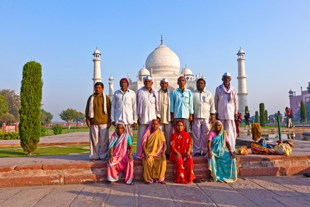 AGRA, INDIA - NOVEMBER 16: indian people visit the Taj Mahal and pose proudly for a photo on November 16,2011 in Agra. 4 Mio. people visit the Taj yearly. Publikacyjne