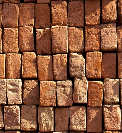 red stapled bricks give a harmonic pattern in the sun Stock Photo - 11499668
