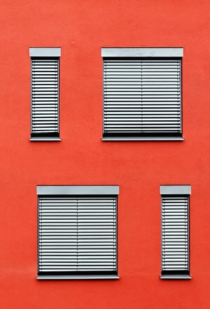 pattern of windows with red wall photo