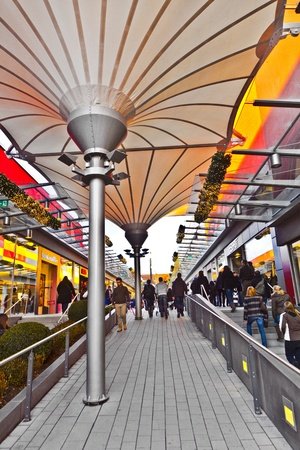 SULZBACH, GERMANY - DEZEMBER 10: people like shopping in the new Mall on Dezember 10, 2011 in Sulzbach, Germany. The new Mall was inaugurated on November 16, 2011 and is the biggest shopping Mall in Germany.