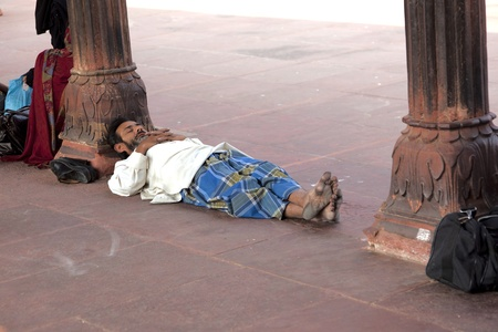 jama mashid: DELHI, INDIA - NOVEMBER 09: pilgrim sleeps in Jama Masjid Mosque on November 11,2011. It is the largest and best-known mosque in India.