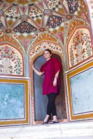 beautiful caucasian woman posing in Amber Fort, India photo