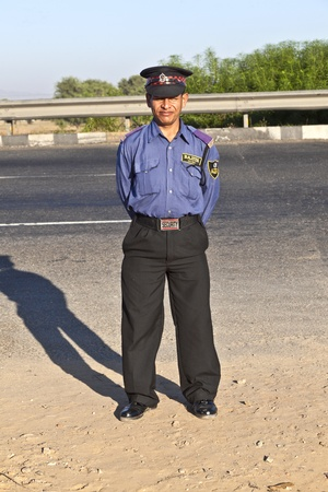 JAIPUR, INDIA - NOV 12: A private guardin uniform protects the parking place and the restaurant at the highway Delhi - JAIPUT on November 11,2011 in Delhi, India. Stock Photo - 11555913