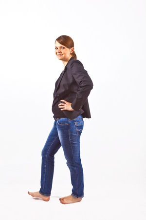 Business woman smiling and looking serious photo