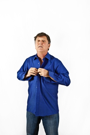 get dressed: business man get dressed with a blue shirt