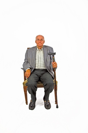 sit studio: old man sitting in the armchair with his walking stick