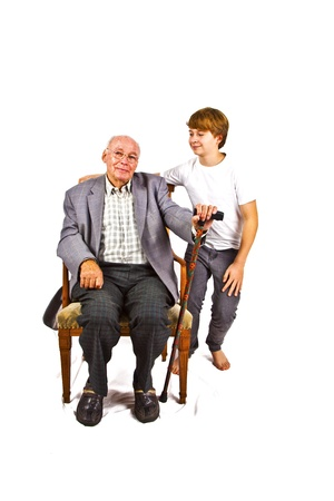 old man sitting in the armchair with his walking stick Stock Photo - 11758414
