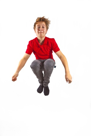 happy boy with red shirt jumping photo