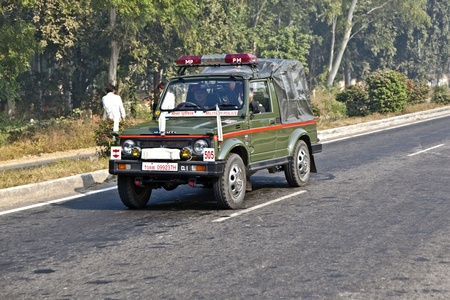 AGRA, INDIA - NOVEMBER 16: military police patrols on the Highway on November 16, 2011 near Agra, India. NH2, a modern divided highway, connects the 200 km distance from Delhi to Agra.