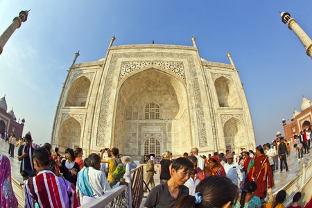 AGRA, INDIA - NOV 16:  local tourists pose for a photo at the Taj Mahal on November 16, 2011 in Agra, India. 2,5 Mio. local tourists visit the UNESCO World heritage site yearly. Publikacyjne