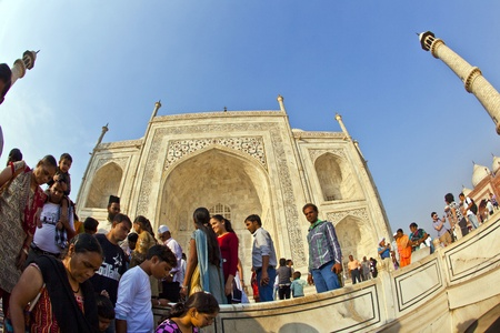 AGRA, INDIA - NOV 16:  local tourists pose for a photo at the Taj Mahal on November 16, 2011 in Agra, India. 2,5 Mio. local tourists visit the UNESCO World heritage site yearly.