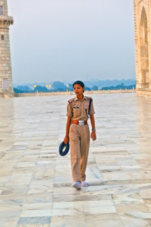closing time: AGRA, INDIA - NOV 16:  officer forces people to leave the Taj Mahal due to closing time  on November 16, 2011 in Agra, India. 2,5 Mio. local tourists visit the UNESCO World heritage site yearly.