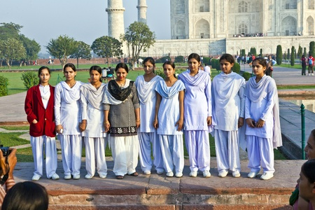 AGRA, INDIA - NOV 16:  local tourists pose for a photo at the Taj Mahal on November 16, 2011 in Agra, India. 2,5 Mio. local tourists visit the UNESCO World heritage site yearly. It is open from 6am to 7pm daily. Stock Photo - 11719783