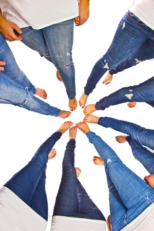 feet of girls with jeans in a circle photo