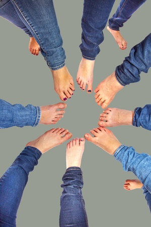 feet of girls with jeans in a circle Stock Photo - 11760054