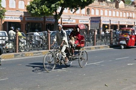 JAIPUR, INDIA - NOVEMBER 12: Cycle rickshaws withpeople in the streets on November 12, 2011 in Jaipur, India. Cycle rickshaws were introduced in the 1940's and have a fixed quota of licenses. Stock Photo - 11767663