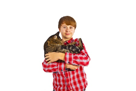 cute boy hugging with his cat photo