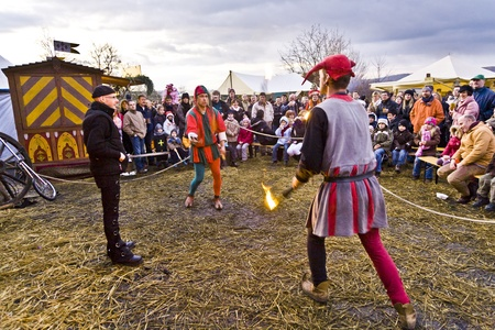 a cudgel: RONNEBURG, GERMANY - DECEMBER 07: Knight festival at the famous Ronneburg on December 7, 2008 in Ronneburg, Germany. Juggler present their games with cudgel to spectators. Editorial