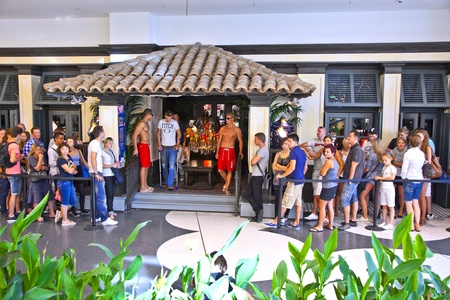 queueing: FRANKFURT, GERMANY - AUGUST 21: people queue to enter Hollister shop on August, 21,2010 in Frankfurt, Germany. Hollister opend this first shop in Germany at April 5, 2010. Editorial