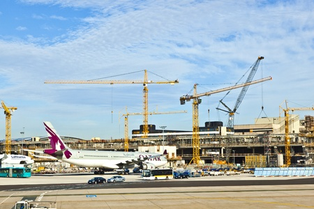 FRANKFURT, GERMANY - AUG 25: Qatar Airways Flight ready to head to runway on August, 25, 2011 in Frankfurt, Germany. New Terminal A is under construction for airport enlargement.
