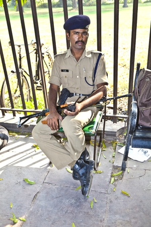 DELHI, INDIA - NOVEMBER 9: policeman pays attention in the Red Fort to protects visitors from crime on November 9,2011 in Delhi, India.