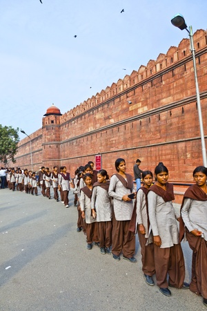queueing: DELHI, INDIA - NOVEMBER 9: scholars in uniform visit the Red Fort on November 9,2011 in Delhi, India. Schools uniforms are compulsory in India, from primary to higher-secondary level.