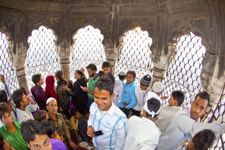 jama mashid: DELHI - NOVEMBER 09: Muslim pilgrims in the top of the minaret of the Jama Masjid mosque on November 09, 2011 in Dehli, India. Jama Masjid is the largest mosque in India with millions of visitors each year. Editorial