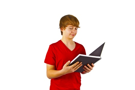 smart boy reading in a book photo