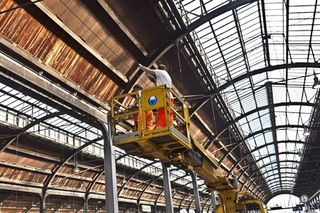 WIESBADEN, GERMANY - October 3: workers repaire the more than 100 years old roof of classicistical train station on October 3,2011 in Wiesbaden, Germany.