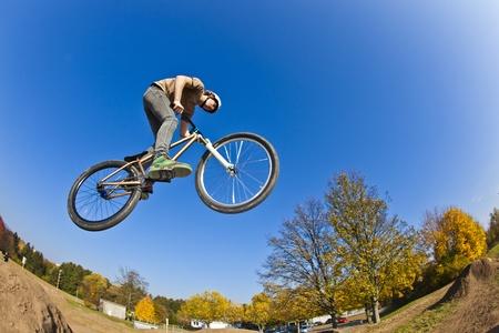 dirt bike: boy going airborne with his dirt bike Stock Photo