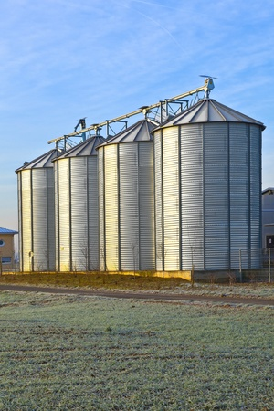 silos in the middle of a field in wintertime Stock Photo - 12017970