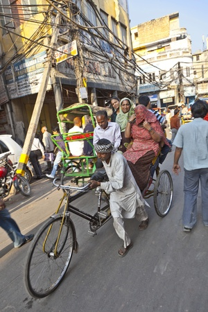 DELHI, INDIA - NOVEMBER 8: Traffic on a street at November 8, 2011 in Old Delhi, India. Indian capital has still problems with traffic and air pollution.