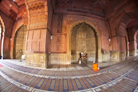 jama mashid: man praying in the Jama Masjid Mosque in Delhi