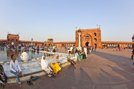 jama mashid: DELHI, INDIA - NOVEMBER 8: A group of worshipers rest on the courtyard of Jama Masjid Mosque in Delhi on November 8,2011. Jama Masjid is the principal mosque of Old Delhi in India.