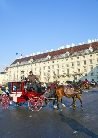 VIENNA, AUSTRIA - NOV 26: driver of the fiaker wait for tourists on November 26,2010 in Vienna, Austria. Since the 17th century, the horse-drawn carriages characterize Viennas cityscape. Stock Photo - 12059833