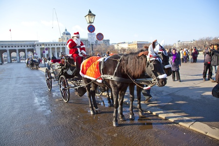 VIENNA, AUSTRIA - NOV 26: driver of the fiaker is dressed as Santa Claus on November 26,2010 in Vienna, Austria. Since the 17th century, the horse-drawn carriages characterize Viennas cityscape. Stock Photo - 12059841
