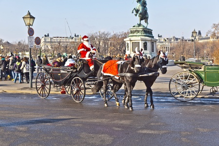 VIENNA, AUSTRIA - NOV 26: driver of the fiaker dressed as Santa Claus on November 26,2010 in Vienna, Austria. Since the 17th century, the horse-drawn carriages characterize Viennas cityscape.