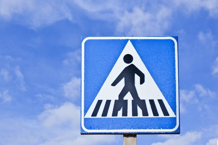 pedestrian crossing sign with blue sky photo